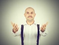 Handsome bald man ready to hug you Royalty Free Stock Photos