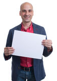 Handsome bald man showing blank signboard Royalty Free Stock Photo