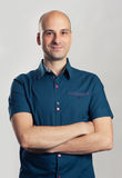 Handsome bald man smiling Stock Image