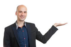 Handsome bald man in suit presenting something Royalty Free Stock Photos
