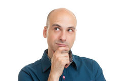 Handsome bald man thinking Royalty Free Stock Images
