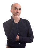 Handsome bald man thinking and looking up Royalty Free Stock Photography