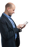 Handsome bald man using a digital tablet Royalty Free Stock Images