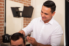 Handsome barber at work Stock Photo