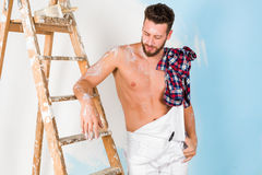 Handsome bare chest painter Stock Photos