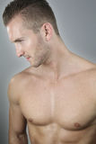 Handsome bare chested man Stock Photos