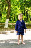 Handsome barefoot little boy standing waiting Royalty Free Stock Photo