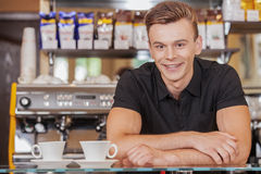 Handsome barista behind counter with coffee. Stock Photography