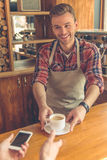 Handsome barista at cafe Stock Image
