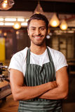Handsome barista posing with arms crossed Stock Photo