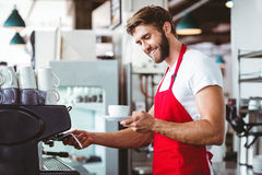Handsome barista preparing a cup of coffee Stock Photography
