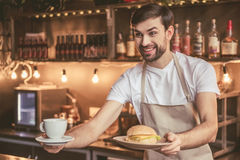 Handsome barista working Royalty Free Stock Photos