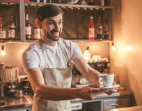 Handsome barista working Royalty Free Stock Photography