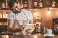Handsome barista working Stock Images