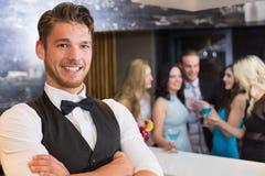 Handsome barman smiling at camera. At the bar Stock Photo