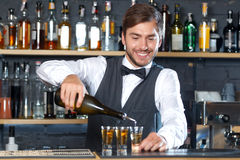 Handsome bartender making shots Royalty Free Stock Photography