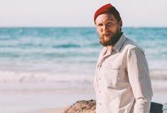 Handsome beard man walking on ocean beach summer traveling vacations royalty free stock image