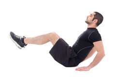 Handsome bearded arabic man in sportswear doing exercises for ab Royalty Free Stock Photography