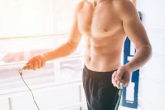 Handsome bearded boxer with bare torso is practicing at the fight club Royalty Free Stock Photography