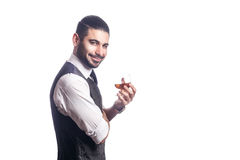 Handsome bearded businessman holding a glass of whiskey. Royalty Free Stock Photos