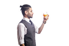 Handsome bearded businessman holding a glass of whiskey. Stock Photo
