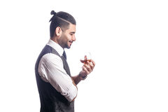 Handsome bearded businessman holding a glass of whiskey. Stock Photography