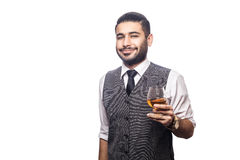 Handsome bearded businessman holding a glass of whiskey. Royalty Free Stock Image