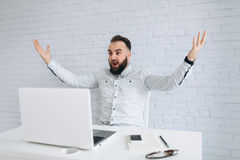 Free Handsome Bearded Businessman Unhappy With The Result Work. Royalty Free Stock Photo - 84795565