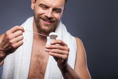 Handsome bearded guy is caring of his body Stock Photos