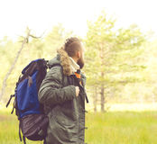 Handsome, bearded guy hiking in swamps and enjoying the views. C Royalty Free Stock Photos