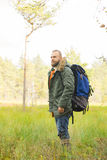 Handsome, bearded guy hiking in swamps and enjoying the views. Stock Photography