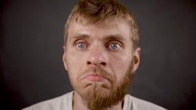 Handsome bearded hipster male mistruts in the black studio.  stock video