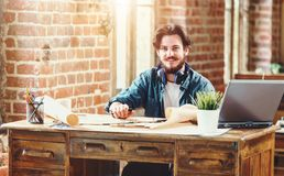 Handsome Bearded Male Architect Working On A Building Plan stock photo