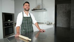 Handsome Bearded Man In Apron Posing In The Kitchen. He Looks So Happy. HD, Indoors, Portrait stock video footage
