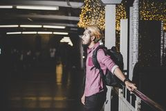 Handsome bearded man with backpack standing on the street while. Traveling at night stock photos