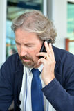 Handsome bearded man calling by mobile phone Stock Images