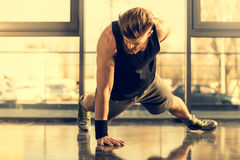 Handsome bearded man doing push ups exercise in gym Royalty Free Stock Photography