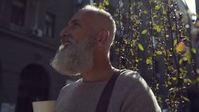 Handsome bearded man drinking delicious coffee outdoors stock video