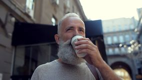 Handsome bearded man enjoying cup of coffee stock footage