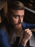 Handsome bearded man is expressing his aspiration Stock Image