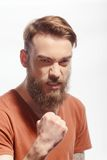 Handsome bearded man getting furious Stock Photography