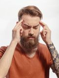 Handsome bearded man with headache Stock Photography