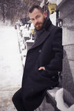 Handsome bearded man in jacket outdoors. Snow cold weather Royalty Free Stock Photography