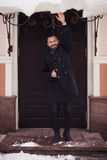 Handsome bearded man in jacket outdoors. Snow cold weather Stock Photos