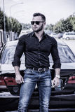 Handsome bearded man next to car in sunglasses Stock Images