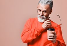 Handsome bearded man with paper cup of morning coffee stock photos