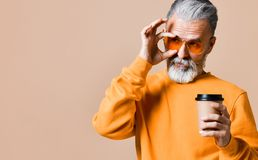 Handsome bearded man with paper cup of morning coffee stock photo