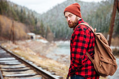 Handsome bearded man on railway road in mountains Stock Photography