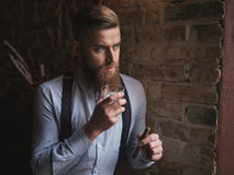 Handsome bearded man is showing his richness Stock Images