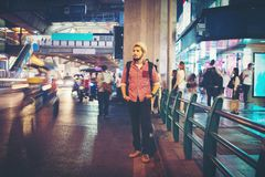 Handsome bearded man standing roadside street while traveling at. Night in bangkok city thailand background stock image